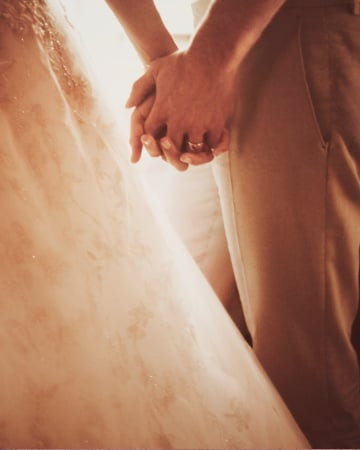 Blake Lively and Ryan Reynolds held hands on their wedding day. Source: Guy Aroch/Martha Stewart Weddings