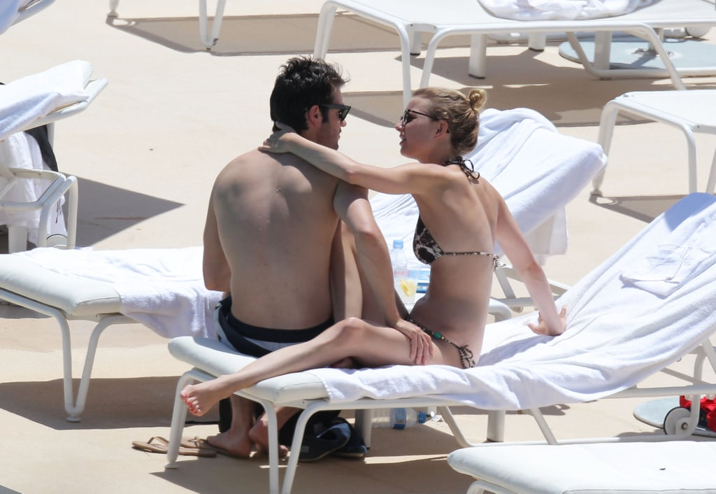 Emily VanCamp and Joshua Bowman showed PDA in the sun.