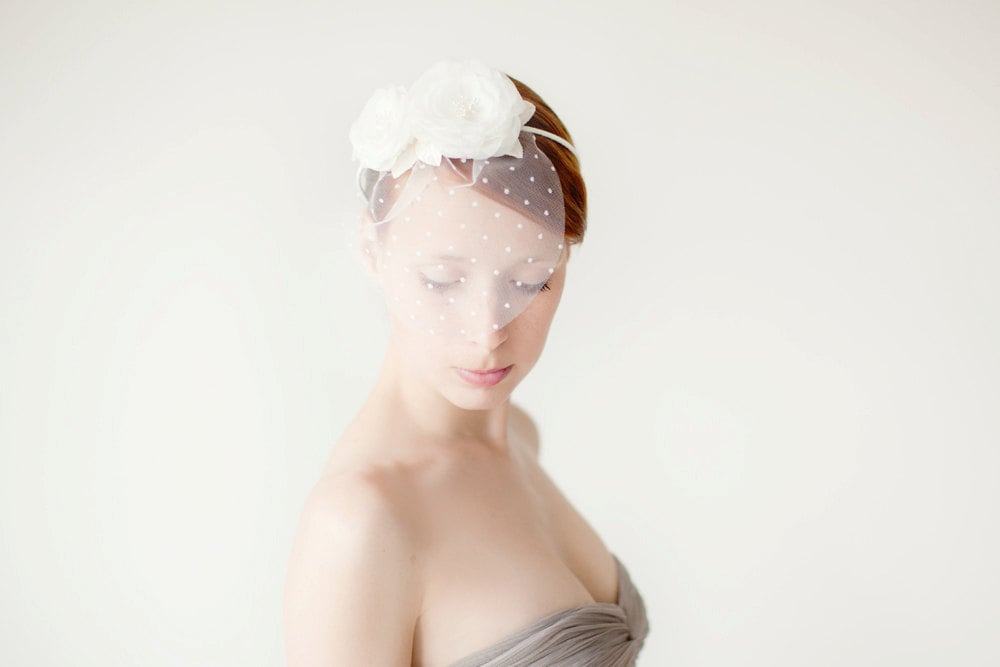 Forgo a traditional veil with this bridal flower headband ($120).