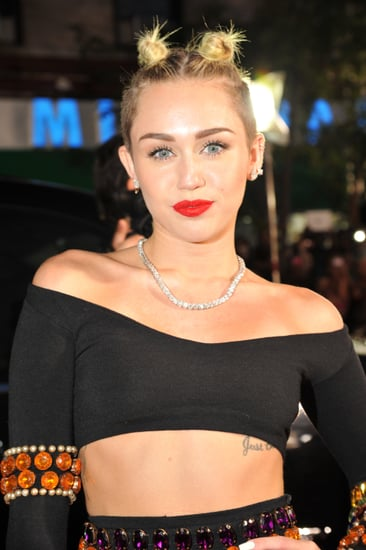 Miley-Cyrus-pulled-her-hair-up-double-topknot-look-her