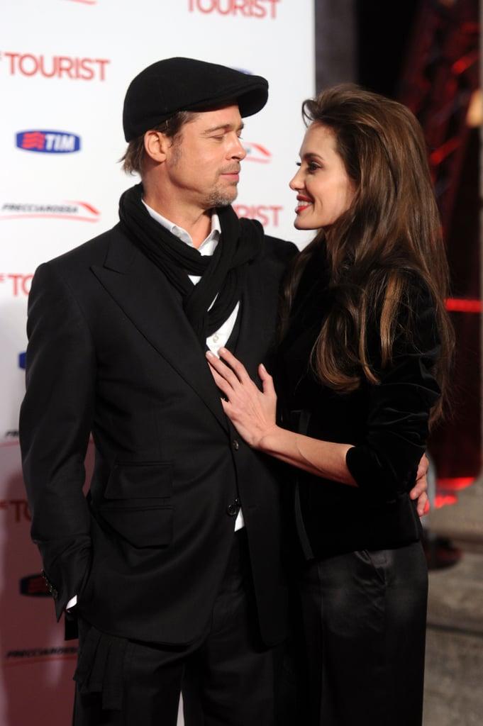 Brad Pitt kept his head under wraps at Angelina Jolie's December 2010 Rome premiere of The Tourist.