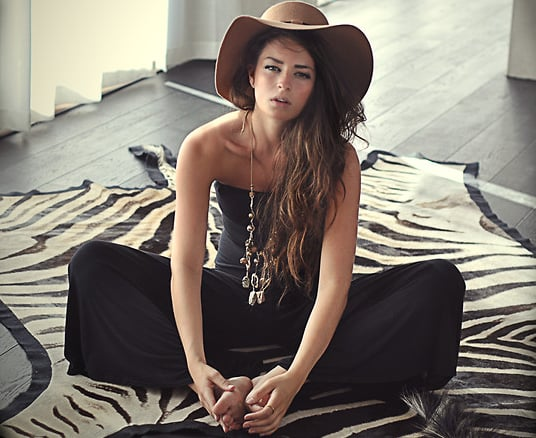 Take a laid-back, and still sexy, approach in a strapless jumpsuit. Then finish with a cool layered necklace and hat for that unmatched '70s-sultry feel. Photo courtesy of Lookbook.nu