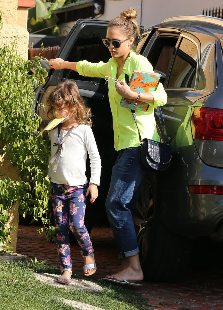 Jessica enjoyed a sunny day in West Hollywood in a neon-green blouse, cuffed Current/Elliott boyfriend denim, and round print sunglasses.