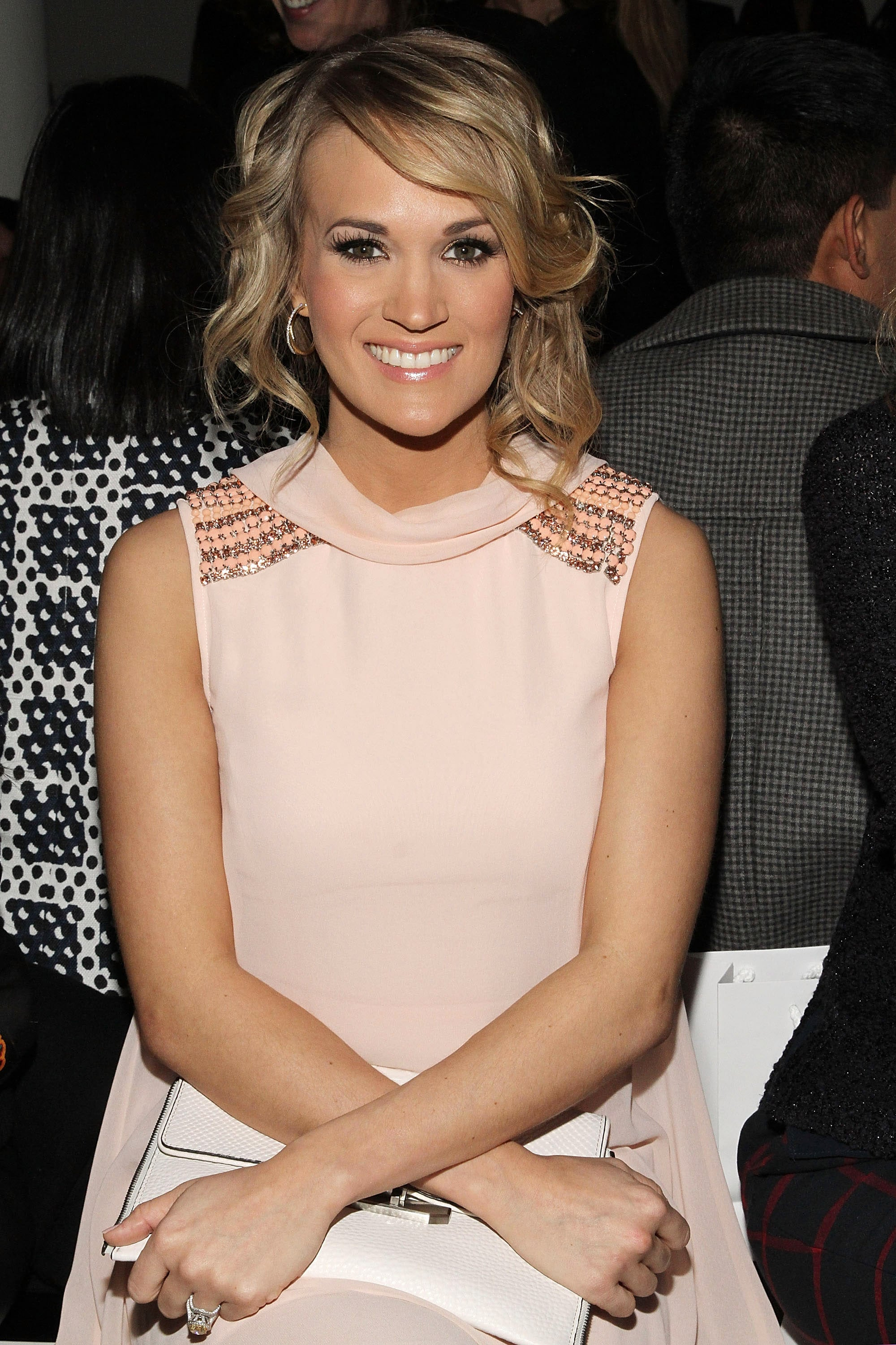 """POPSUGAR: First off, any tips on doing the perfect smoky eye yourself? Carrie Underwood: I think practice is important. If you have a day that you're not really doing anything, like some random Sunday, just play a little bit and try something new. Whatever that new thing is, whether it's a smoky eye or trying to do a little more with eyeliner. Just try new things, and every time you'll get better and better. PS: Have you always been good at your own makeup? Did friends ask you to do theirs when you were younger? CU: I've always loved it. I will say, there was a lot of trial and error, as so many teenagers go through when they're figuring everything out. People will ask me to [do their makeup, but] it's so different — drawing on someone else is different than drawing on yourself. I'll do my mom's sometimes, because she'll ask me, """"How do I use this? What do I do with this?"""" PS: You've said doing your own makeup before a concert is therapeutic; what about your nighttime skin routine?"""