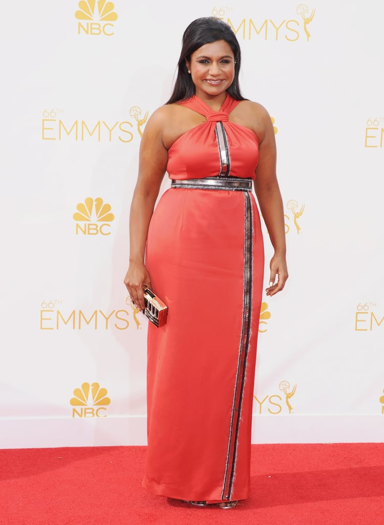 Lighting up the Emmy Awards in a bright coral Kenzo gown in 2014.