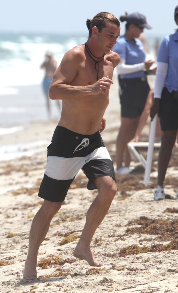 A shirtless Gavin Rossdale jogged on the sand.