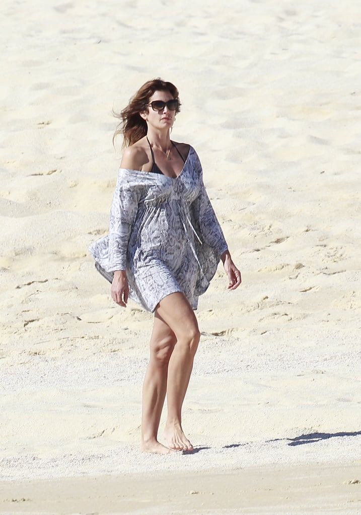 Cindy Crawford Covers Up For a Relaxing Beach Stroll