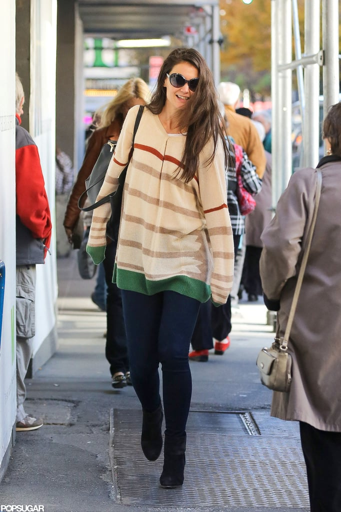 Katie Holmes smiled on her trek to her Broadway show.