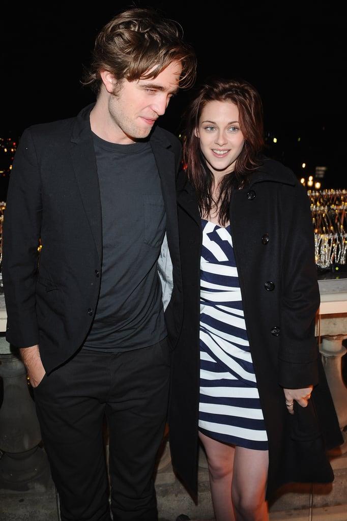 Robert Pattinson and Kristen Stewart enjoyed the view at a Paris photocall in December 2008.