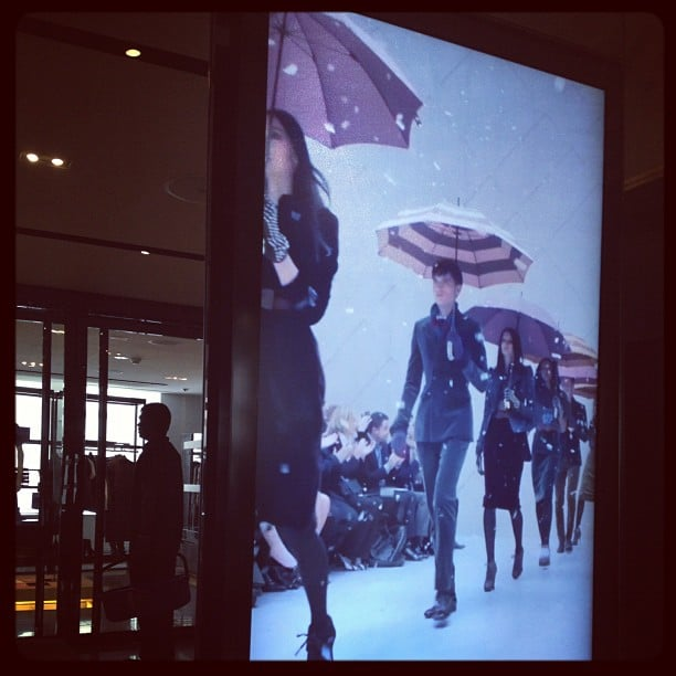 Spotted: Burberry catwalk models strutting their stuff (on screen) at a Burberry launch.