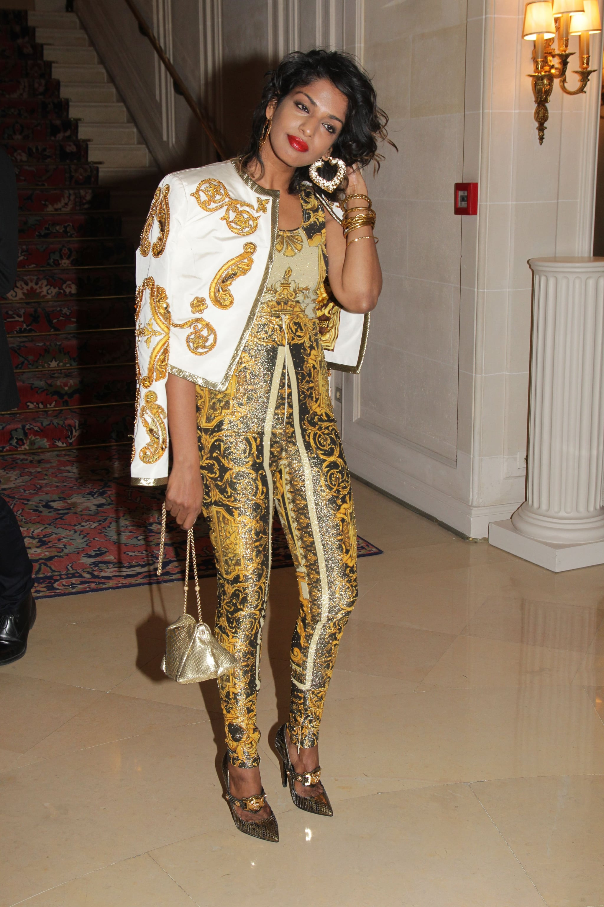 M.I.A. walked into the Versace show for Paris Fashion Week.