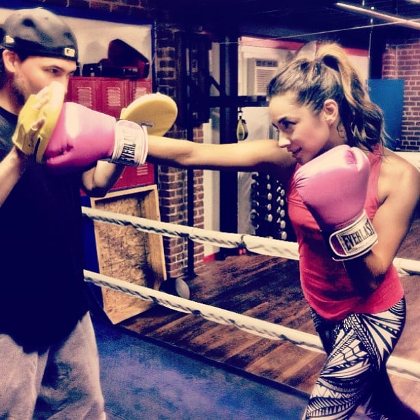 Shay keeps it cute with pink boxing gloves.