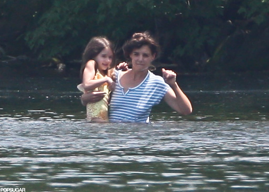 Katie Holmes carried Suri Cruise while taking a dip in a pond in Kent, CT.