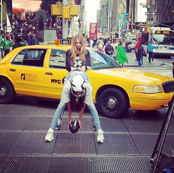 Go team! Jourdan Dunn hiked the ball to Cara Delevingne at DKNY's Times Square shoot. Source: Instagram user caradelevingne