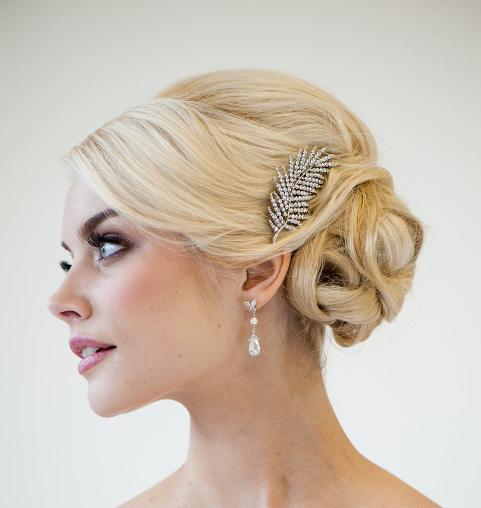 There's a whimsical and vintage vibe about this rhinestone feather hair comb ($50).