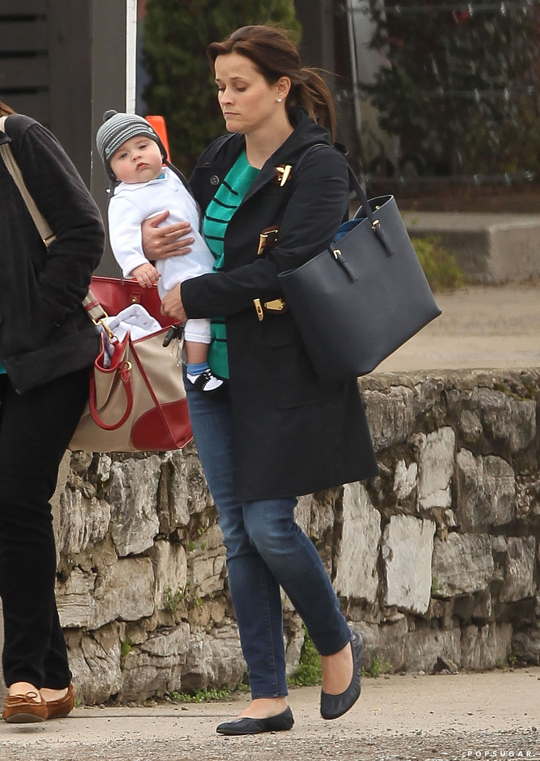 Reese Witherspoon debuted dark brown hair in Nashville with baby Tennessee.