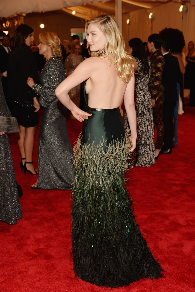 Kirsten Dunst channelled her sexier side in Louis Vuitton gown that bared her back.