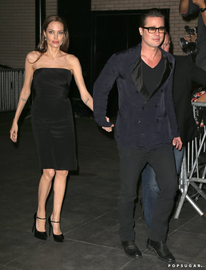 Brad Pitt and Angelina Jolie held hands as they left the Normal Heart premiere in NYC on Monday.