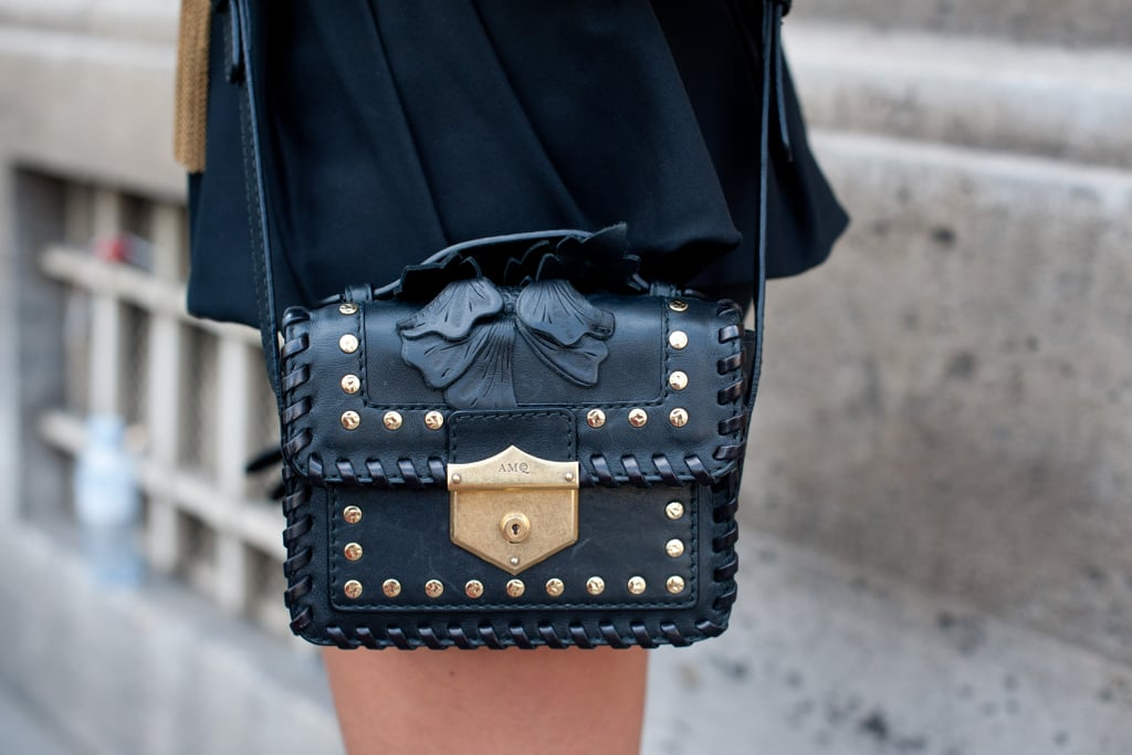 This boxy crossbody bag packed a whole lot of detail into one very compact little tote.