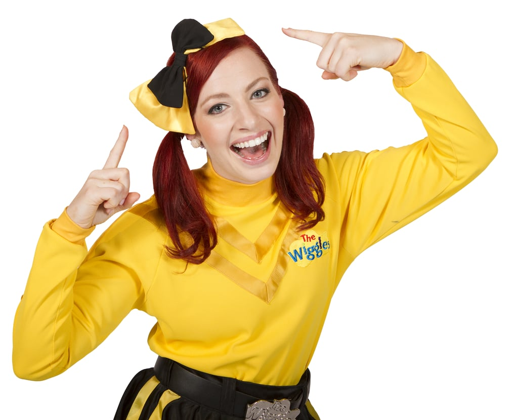 POPSUGAR: Congratulations on not only joining The Wiggles, but also being the first female in the group. How does it feel holding that title in what's always been an all-male group? Emma Watkins: It's quite exciting. I actually watched The Wiggles when I was growing up — I idolized them, and I don't think I ever thought that I would be one, particularly being a girl. This is probably the most exciting thing that's ever happened to me PS: Being the only female puts you in a position to be a role model for young girls. How does that feel? EW: It's really hit me this year. A lot of the children — girls and boys — are coming to the shows wearing big yellow bows, because I wear this big yellow bow in my hair. I think that reflects, to me, that the children are really getting into the new Wiggles. There are so many parents posting pictures of their children wearing the bows, and it's been a wonderful thing to see.  PS: What's been the biggest challenge for you? EW: The most challenging thing is just trying to balance the time. I think that's the best part about being the youngest, too. It's been the most diverse part of my life, and I've been able to travel and meet children all around the world, which I probably wouldn't have been able to do in any other job. Source: The Wiggles
