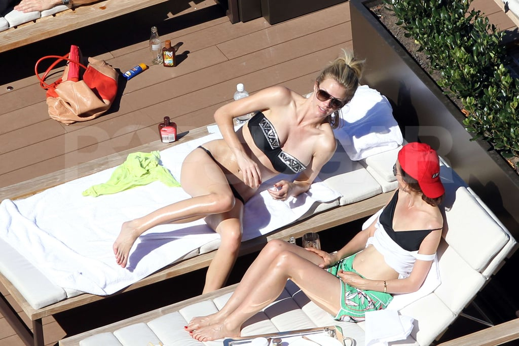 Brooklyn Decker chatted with a friend while laying out in her bikini in Australia.