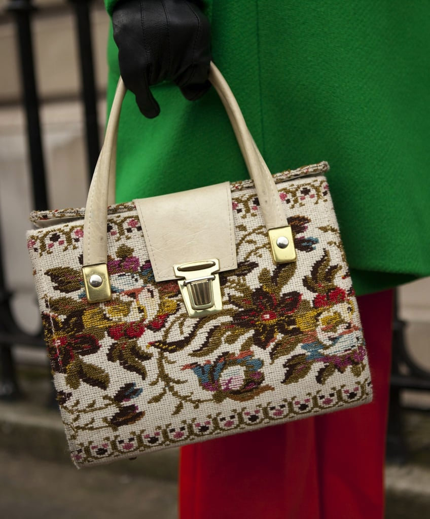 We love the floral tapestry detailing on this structured satchel bag.