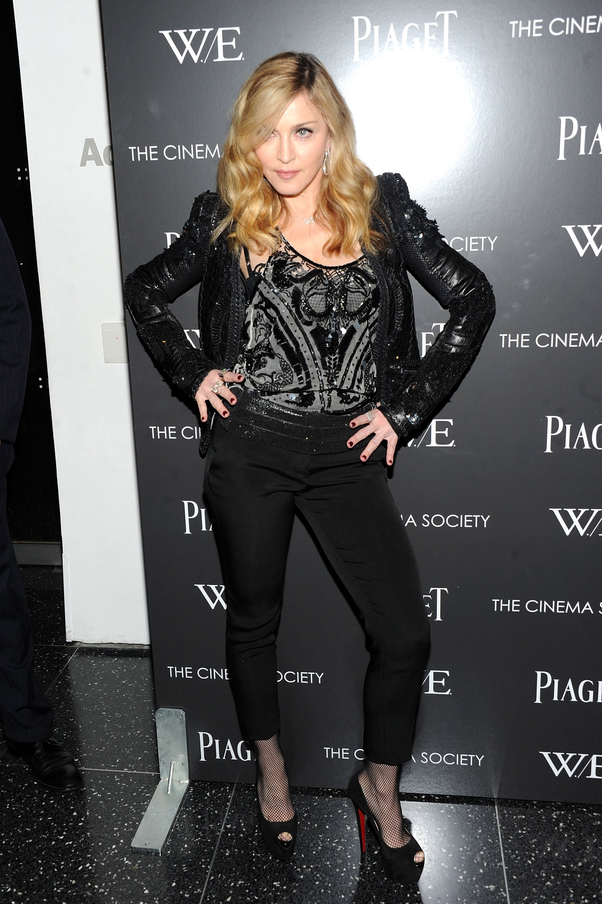 Madonna struck at pose in an embellished top and jacket at a film screening of W.E.