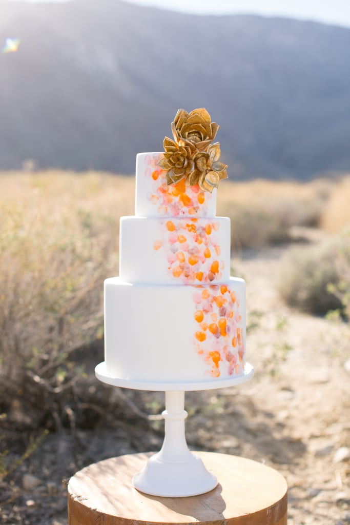 Gold succulents (yes, you read that right) top off this amazing and unique wedding cake.