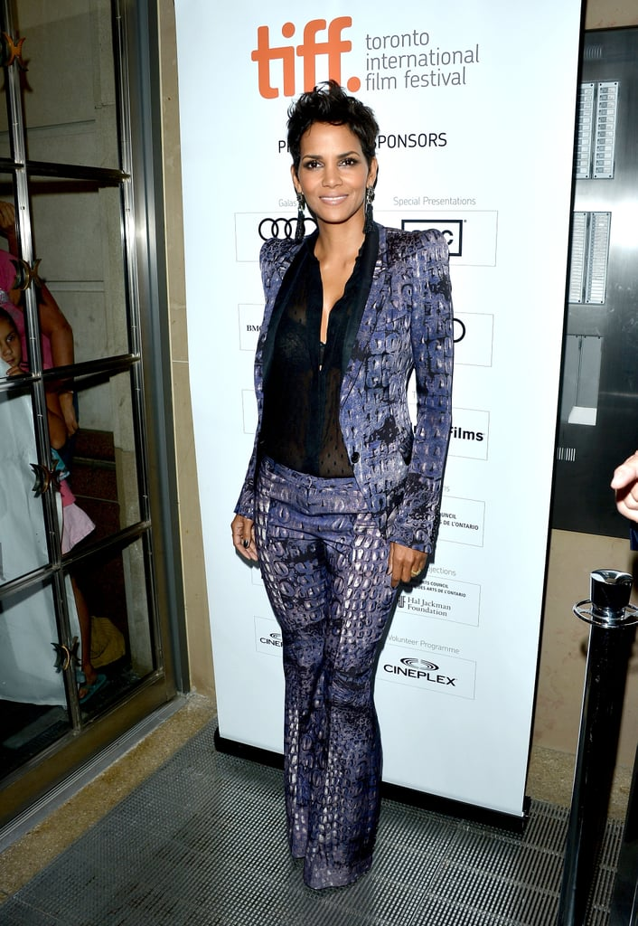 Halle Berry paired a purple printed Roberto Cavalli pantsuit with a semi-sheer black Monique Lhuillier blouse at the Cloud Atlas premiere.