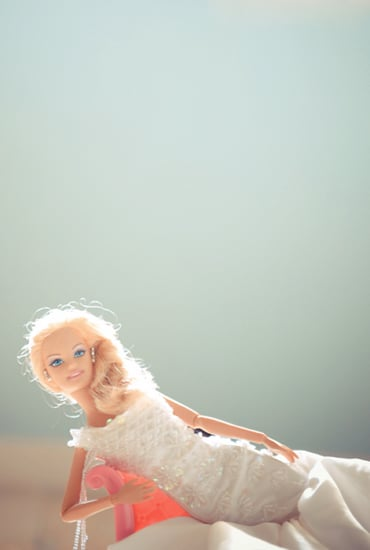 Barbie is beautiful in white. Photo by BdG Photography via Rock n Roll Bride