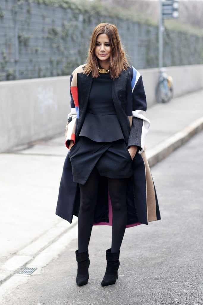 Christine Centenera played expertly with proportion in a peplum top, structured mini, and an oversize coat.
