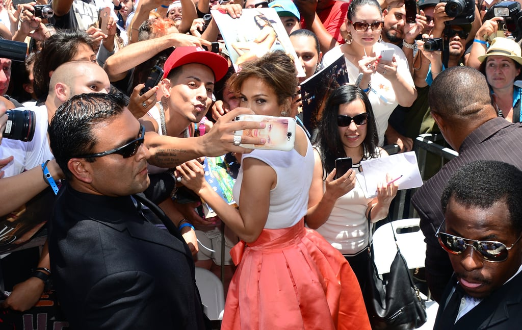 Jennifer Lopez stopped to snap pictures with fans.