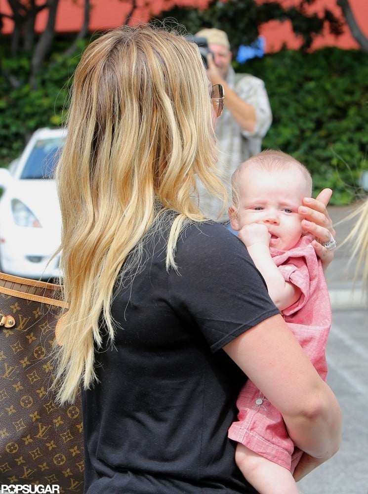 Luca Comrie was dressed in a red jumpsuit and he held on to his mom Hilary Duff in Santa Monica.