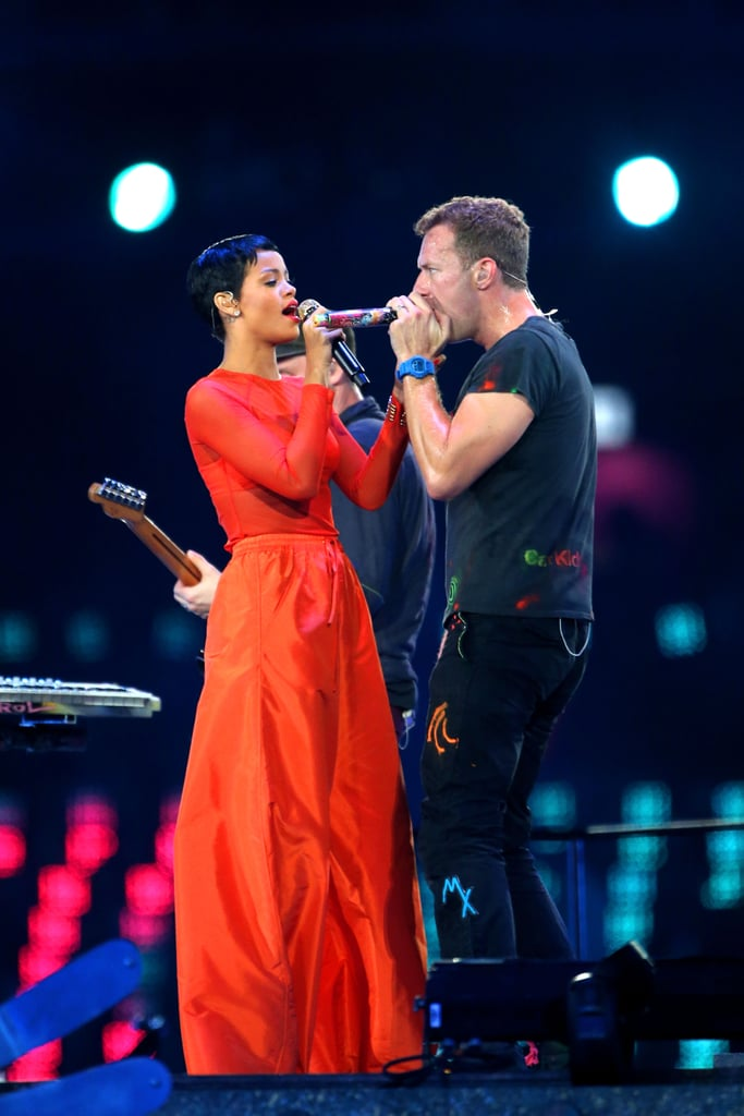 Chris Martin wore black while Rihanna wore an orange ensemble for their London Paralympics closing ceremony performance.