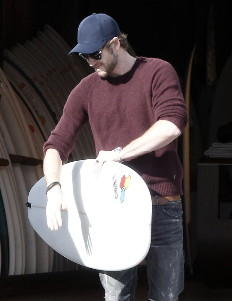 Liam Hemsworth loaded his new surfboard into the car in LA.
