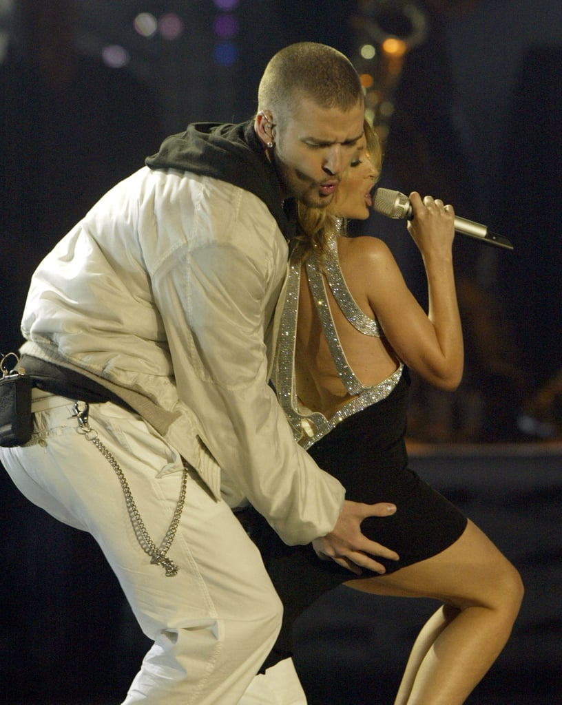 Justin Timberlake gave Kylie Minogue a little squeeze while performing together at the 2003 Brit Awards.
