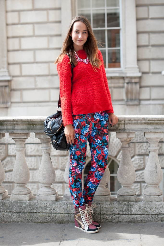 Wearing head-to-toe New Look (a British high street retailer), we're obsessed with her youthful mix of floral trousers, wedge sneakers, and statement jewellery.