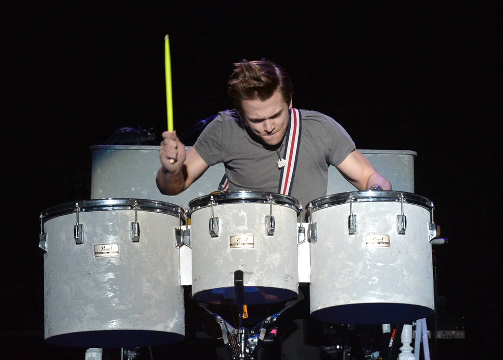 And he plays the drums and has that cute hair-flip thing.