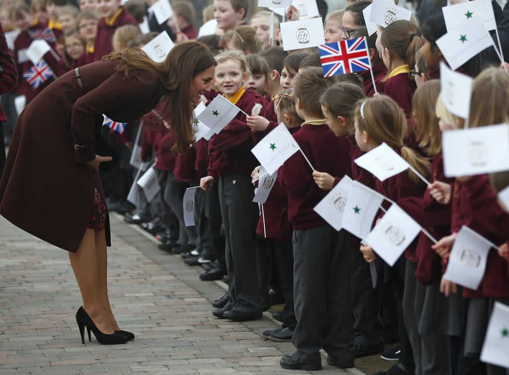 Kate really is the People's Princess! She lived up to her rep by bending down to speak to a group of adorable school kids during a visit to England's Havelock Academy in March.