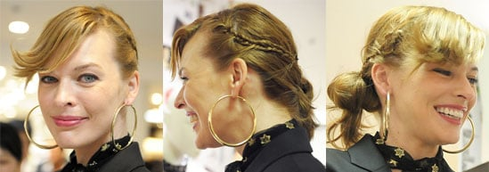 Milla Jovovich Hairstyle With Flippy Bangs, Braids, and Tousled Bun