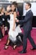 Zoe Saldana got a helping hand with the train of her Alexis Mabille gown.