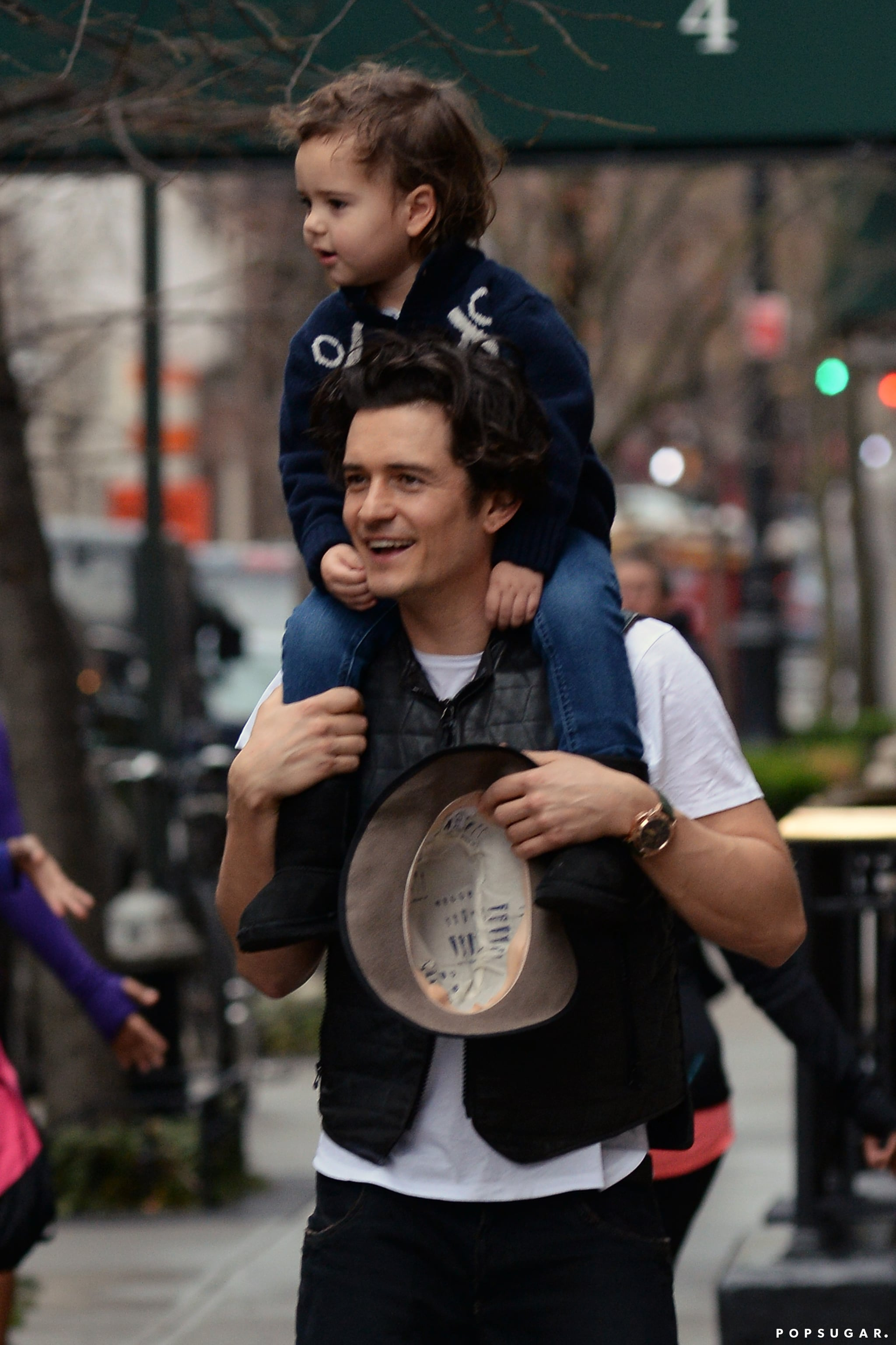 Orlando Bloom gave his son, Flynn, a piggyback ride during a walk in NYC.