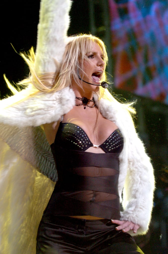 Britney Spears rocked a black bra and furry jacket for a December 2003 Jingle Ball show in LA.