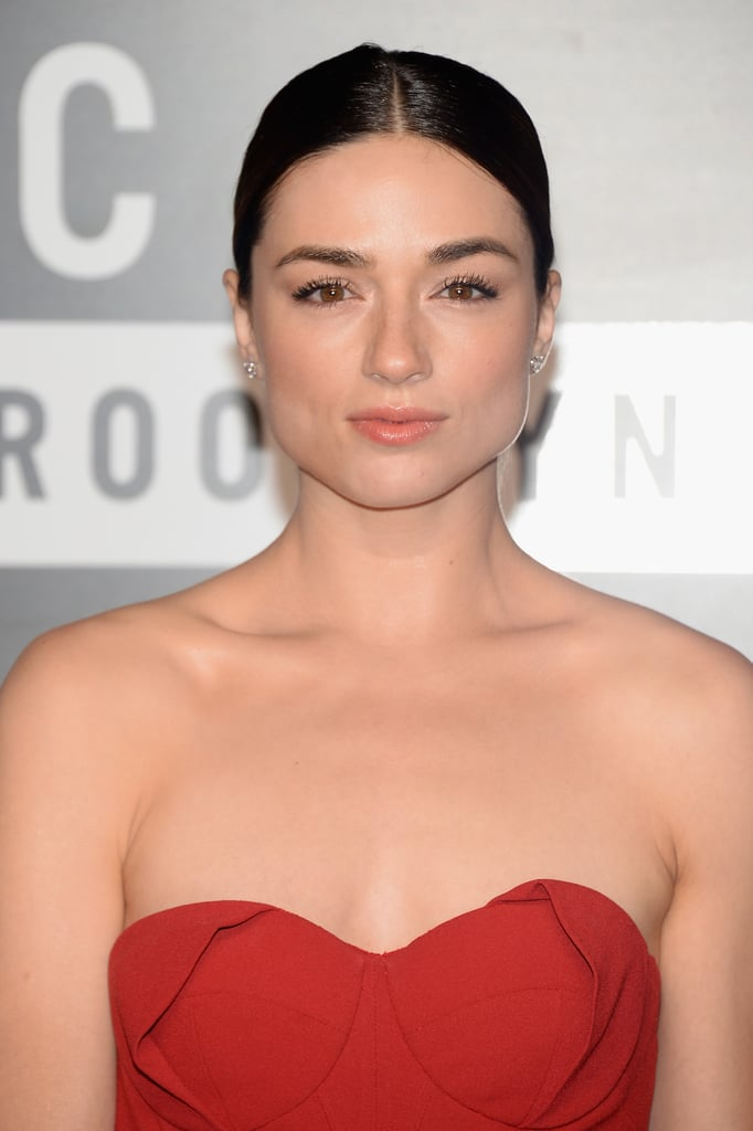 You can never go wrong with a classic, and Crystal Reed kept it simple with a sleek updo and nude makeup palette.