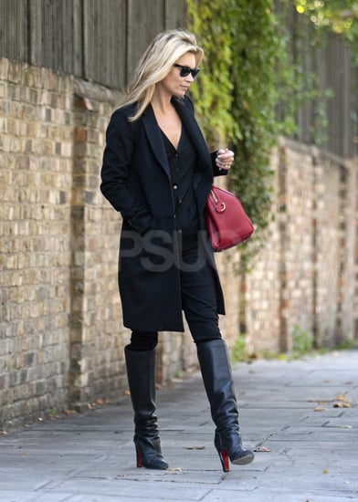 Kate Moss left her house in knee-high boots.