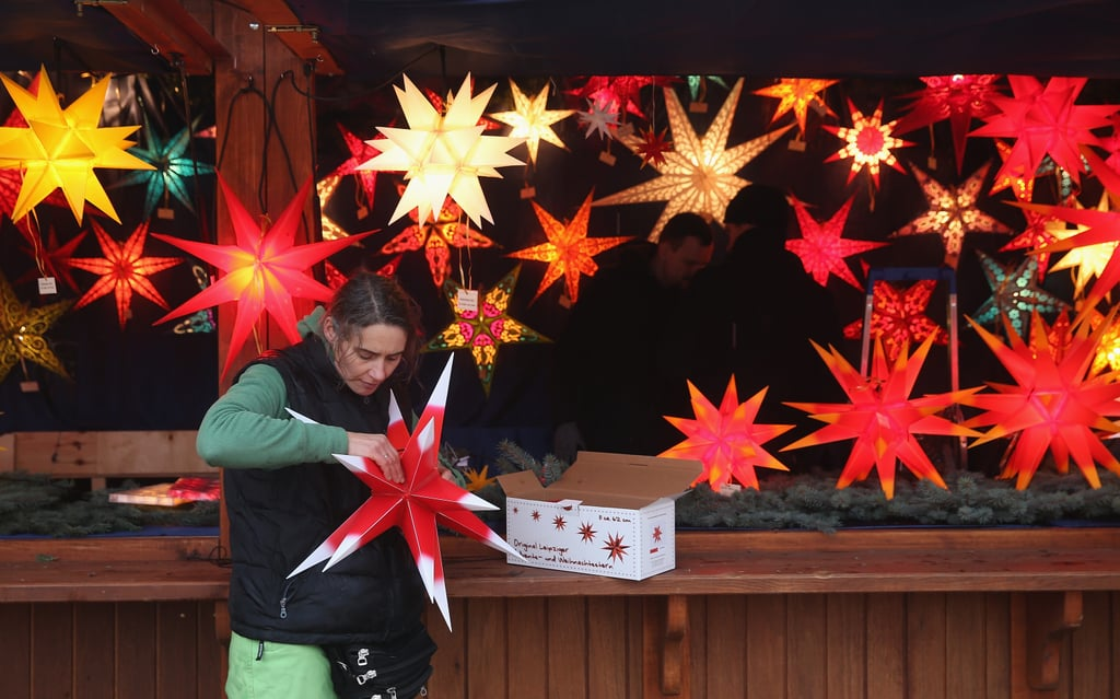 In Berlin, a vendor set up her Christmas-star booth.