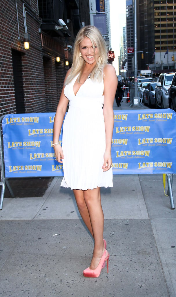 Kate Upton in a white dress.