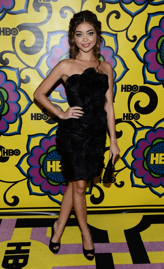 Sarah Hyland swapped her ultrafeminine Marchesa gown from the awards for a rosette-adorned black strapless at the post-Emmys festivities.