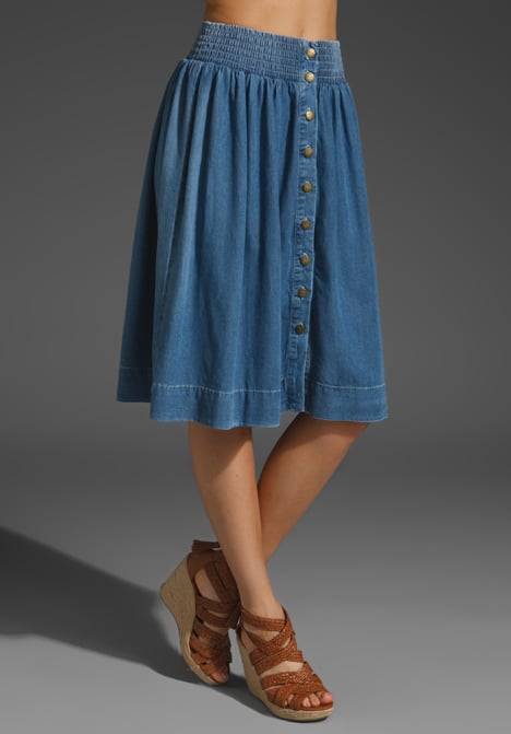 The perfect ladylike length to offset the more casual look of a button-down denim skirt — pair it with a slouchy white t-shirt, and you're country-ready. Current/Elliott The Long Ice Cream Skirt ($238)