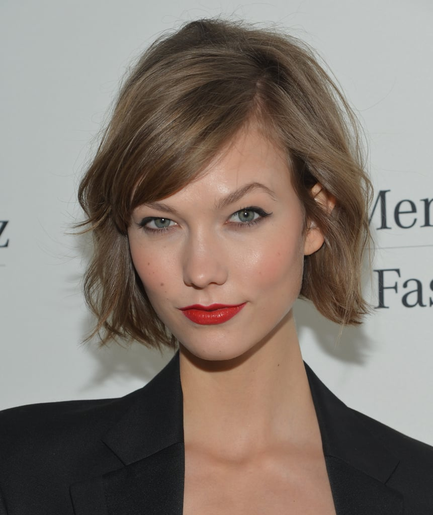 It's official. Our readers and editors alike have chosen Karlie Kloss's chop as the style of the season, especially with her effortless fringe.